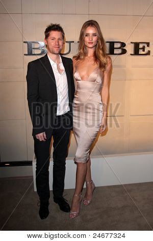 LOS ANGELES - OCT 26: CCO Christopher Bailey and actress Rosie Huntington-Whiteley arriving at the Burberry Body Launch at Burberry on October 26, 2011 in Beverly Hills, CA