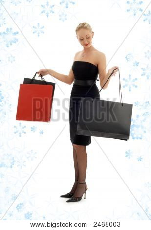 Shopping Blond In Black Dress With Snowflakes