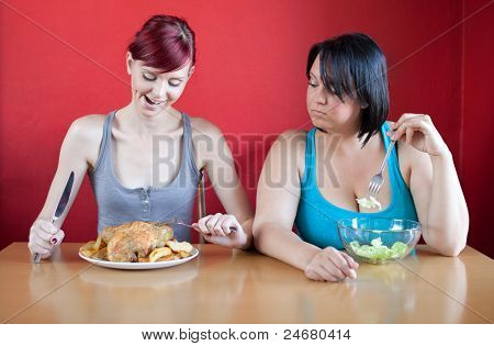 Tailored Diet. Skinny Woman Is Happy Because She Can Eat Huge Meals, While The Overweight Woman Is L