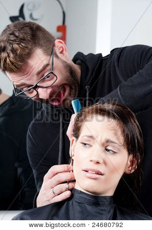 Mad Hairdresser About To Cut Off His Client's Ear. In A Hair Salon.