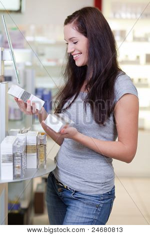 Attractive Happy Young Woman Buying Perfume. Shallow Dof.