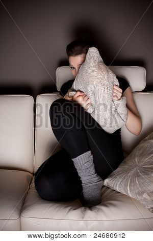 A Scared Beautiful Young Woman Watching A Horror Movie At Home Alone.