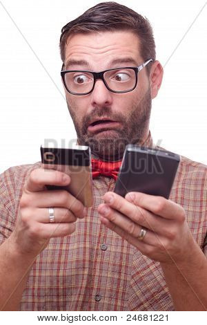 Funny Nerd Torn Between Two Gadgets. Isolated On White.