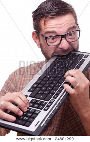 Geek Hysterically Biting The Keyboard