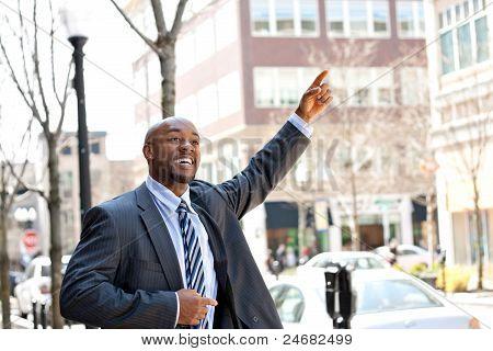 Business Man Hails A Taxi