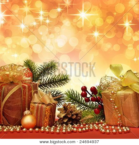 Christmas gift with decoration on color background.