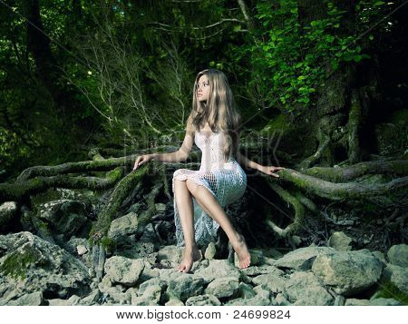 Portrait of beautiful elegant lady in a green rainforest