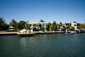 image of pontoon boat  - Luxury homes on a waterway Surfers Paradise Queensland Australia - JPG