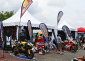 SEPANG - OCT 21: Motorcycle racing fans view the bikes and accessories on show at the Malaysian Moto