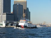 stock photo of coast guard  - us coast guard boat with nyc skyline - JPG