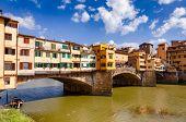 Picturesque Ponte Vecchio (Old Bridge) medieval closed-spandrel segmental bridge over the Arno River poster