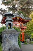 Bronze Lantern By Pagoda In Japanese Garden