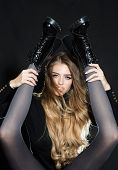 Girls Only Legs Slim Black Tights And Brutal Boots. Lady Cool Make Up Long Hair Holds Skinny Legs In poster
