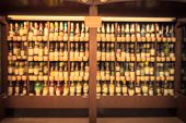 Vintage Blurred Chilled Wine Section At Store In Usa poster