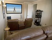 image of home theater  - Home media room with big screen and seating - JPG