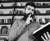 Teacher Or Student With Beard Studying In Library. Scientist Busy With Exploring Book. Man On Busy F poster