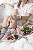 Romantic Breakfast In Bed. A Bouquet Of Roses And A Fragrant Morning Coffee. Fresh Strawberries. Goo poster