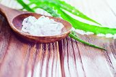 Aloe Vera Gel And Rock Salt On Wooden Background. Spa And Skin Care Concept. Closeup Aloe Vera Leaf. poster