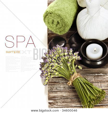 lavender spa (fresh lavender flowers,candlel, zen stones,  Herbal massage balls, towel) on a wooden bord  (with easy removable text)