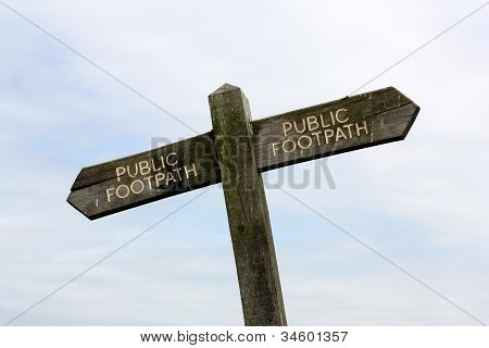 a crooked plublic footpath sign