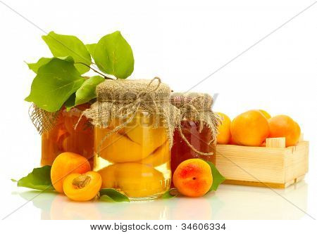 canned apricots and jam in a jars with sweet apricots isolated on white