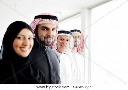 Successful and happy business arabic  people looking at you