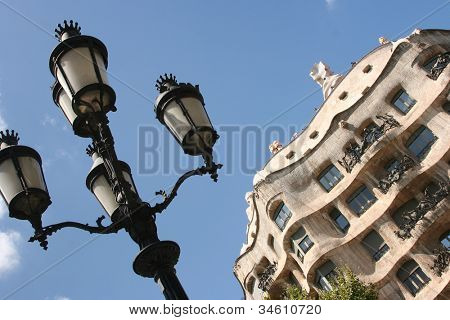 BARCELONA, SPAIN - JULY 20: Casa Mila or La Pedrera on July 20, 2011 in Barcelona, Spain. This building was designed by Antoni Gaudi. Every day La Pedrera is visited by tourists.