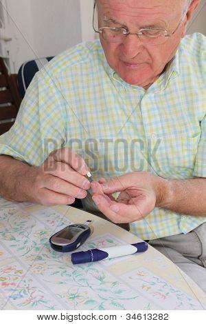 Pensioner Taking Blood Sample
