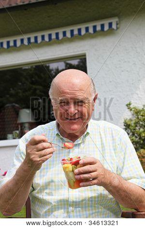 Elderly Man Eating Fresh Fruit Salad