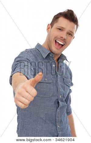 Successful young man showing thumb up, smiling. Yeah.