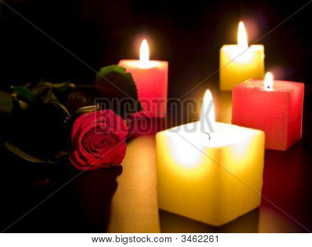 Rose With Candles In Night
