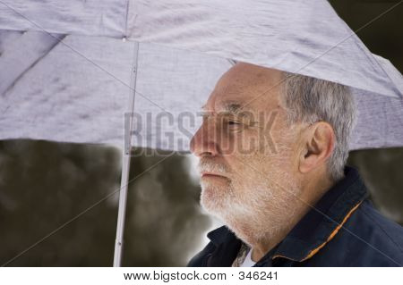 Senior Under Umbrella