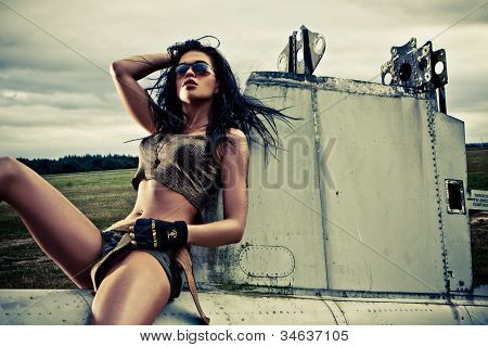Artistic Portrait Of Woman Sitting On Plane