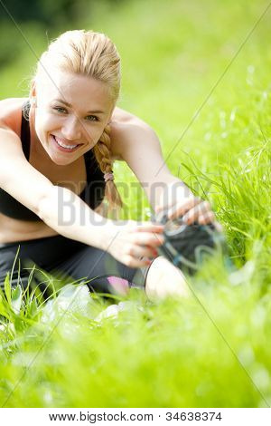 Attractive Woman stretching before Fitness and Exercise