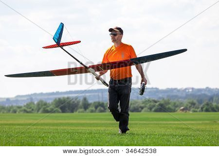 Man Holds The Rc Glider