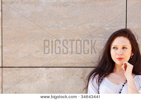 Portrait Of Thoughtful Young Woman Looking On Copyspace