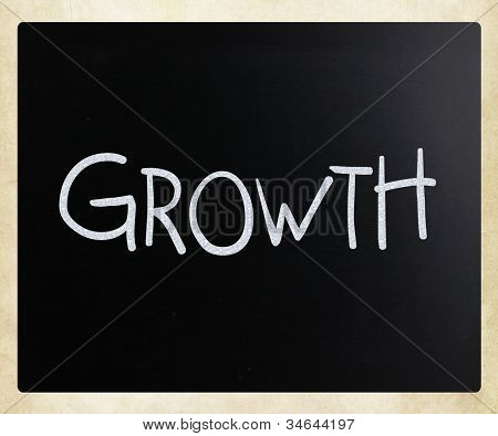 """growth"" Handwritten With White Chalk On A Blackboard"