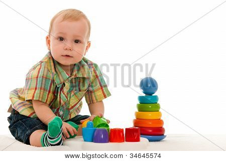 Serious Baby Boy With Toys