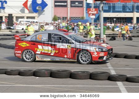 """CLUJ-NAPOCA, ROMANIA - JUNE 22: Unidentified competitor during Rally of Romania 2012 National Championship """"Dunlop""""  on June 22, 2012 in Cluj-Napoca, Romania."""