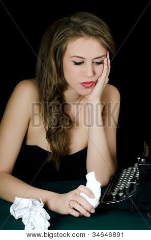 The beautiful girl at a typewriter. Retro