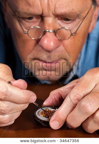 Senior Craftsman Repairing Pocket Watch