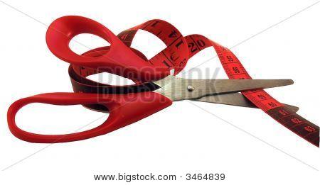 The Scissors Cutting A Measuring Tape