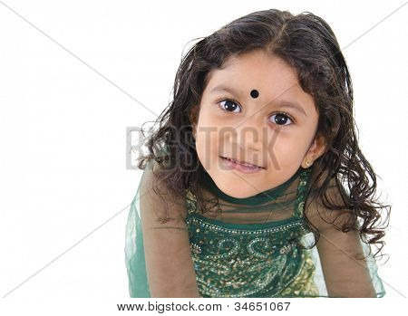 Little Indian girl looking up over white background