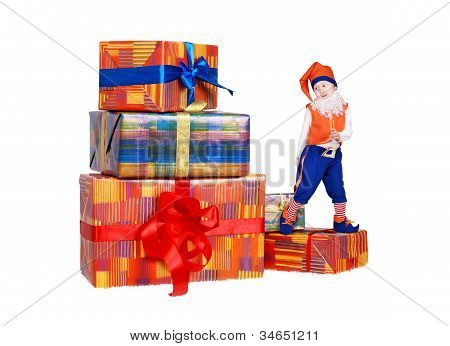 Little Funny Gnome Dancing On Gift Boxes