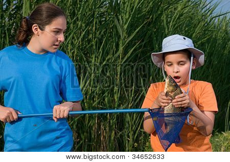 Sister and brother fishing at Mogan Lake