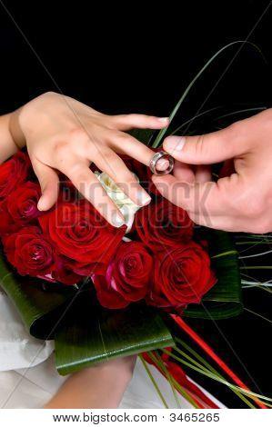 Hands Over Wedding Bouquet
