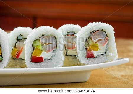 sushi roll of shrimp, cucumber, pepper and sauce
