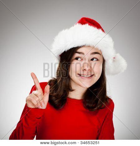 Portrait of beautiful girl wearing Santa Claus hat