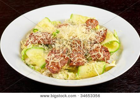 Salad with beef, lettuce, cucumber, string beans, Chinese cabbage and sauce