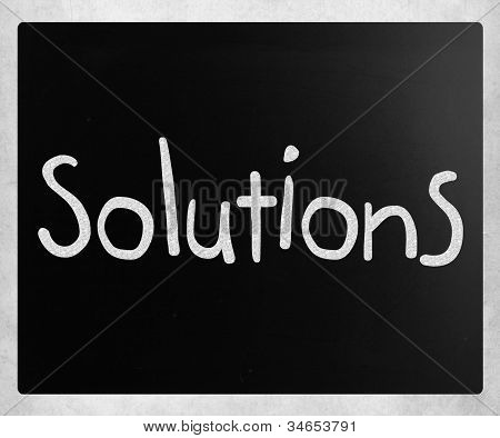 """solutions"" Handwritten With White Chalk On A Blackboard"